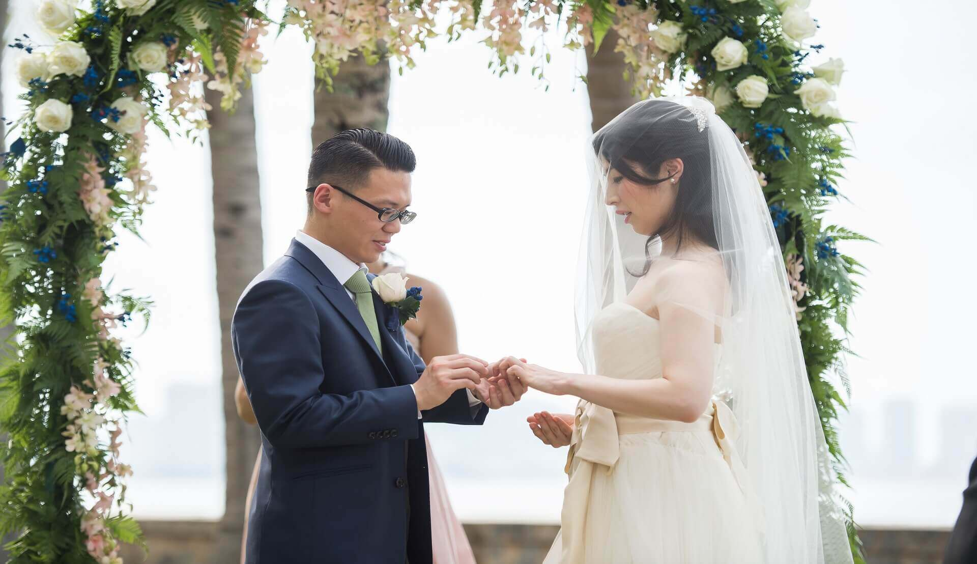 Sugar & Spice Events - Couple exchange wedding ring in the ceremony