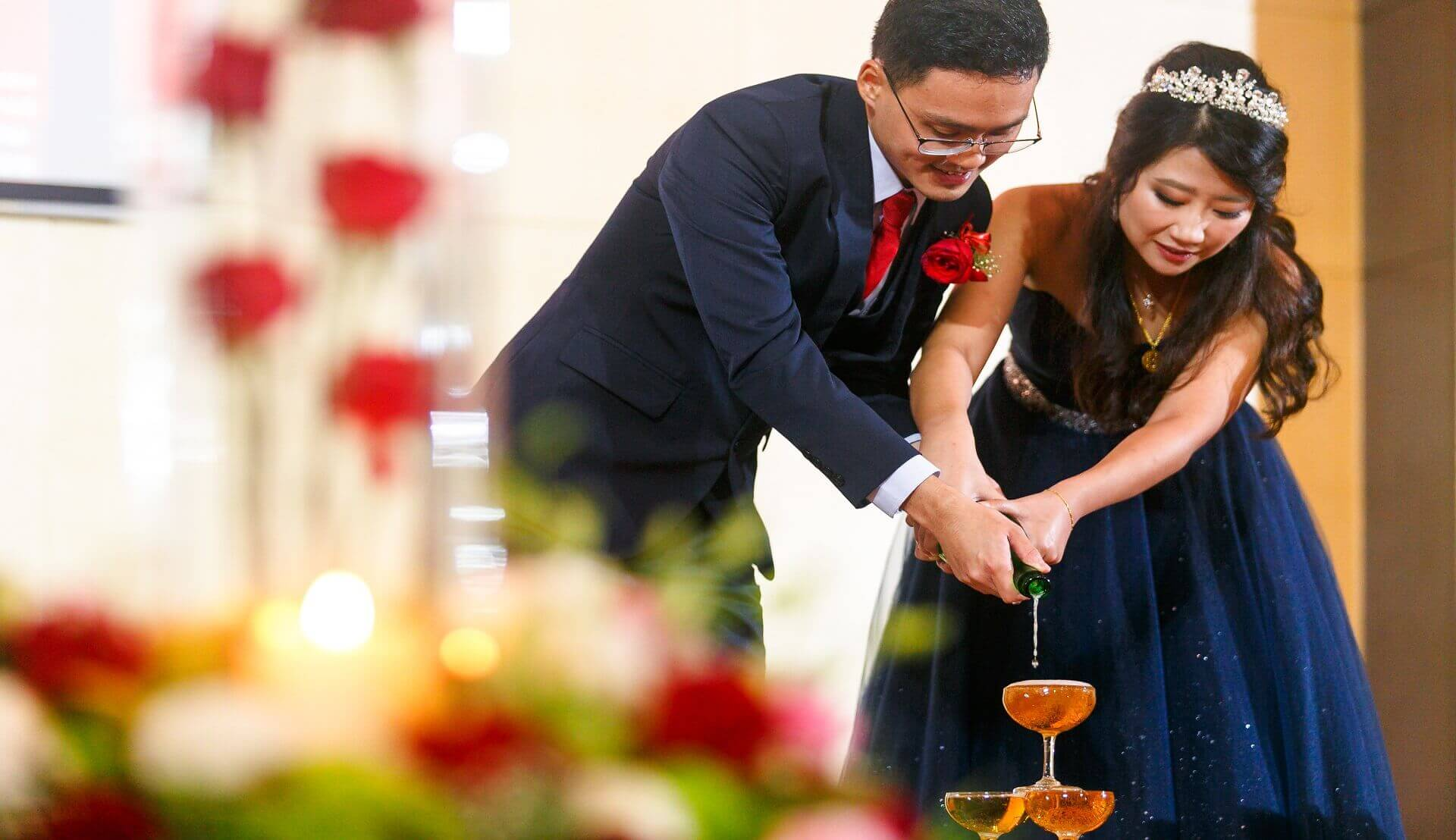 Sugar & Spice Events -Newlywed couple champagne pouring in glasses