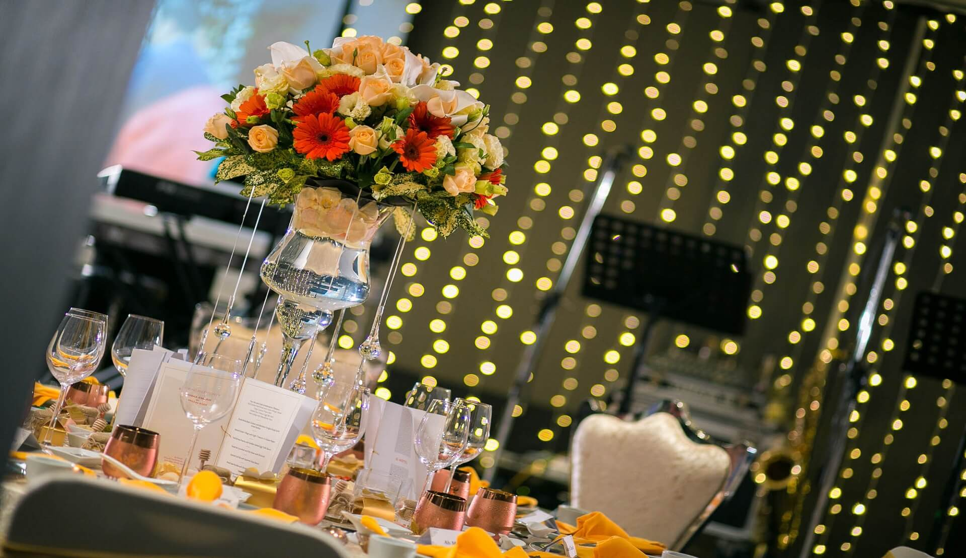 Sugar & Spice Events - Beautiful couple champagne pouring during banquet dinner.